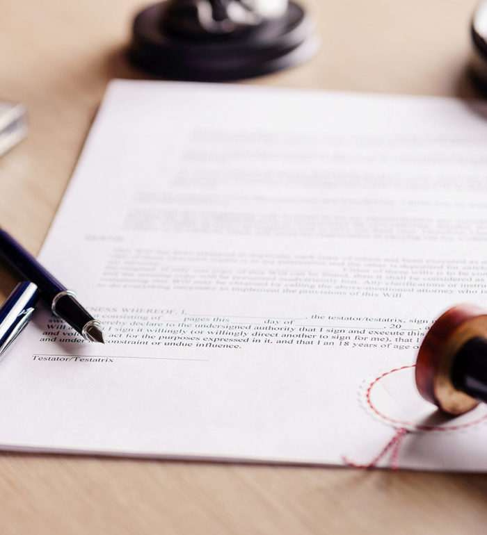 Notary pen lying on testament. Notary public working accesories ** Note: Shallow depth of field
